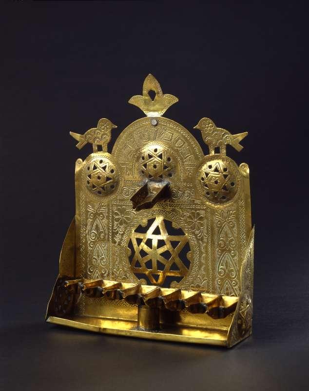 Hanukkah lamp adorned with Stars of David, birds, and fleur-de-lis