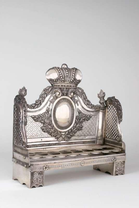 Crowned Hanukkah lamp in the shape of a sofa