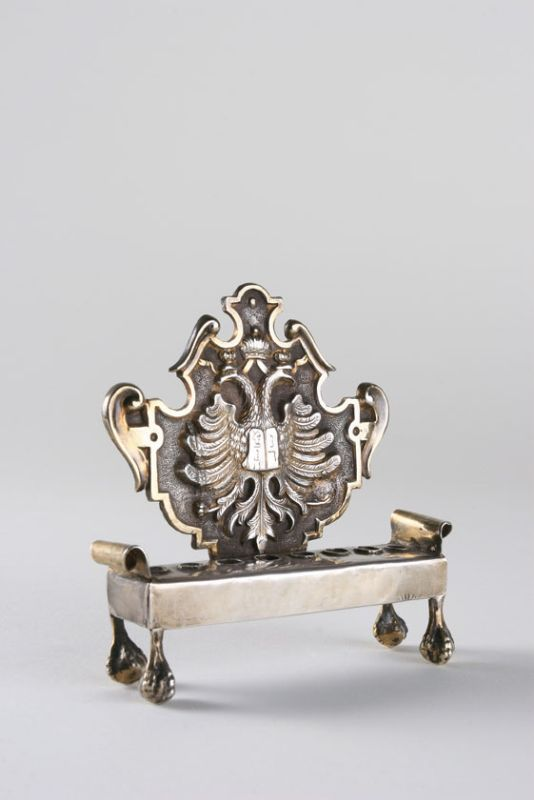 Small Hanukkah lamp adorned with Austrian emblem and Tablets of the Law