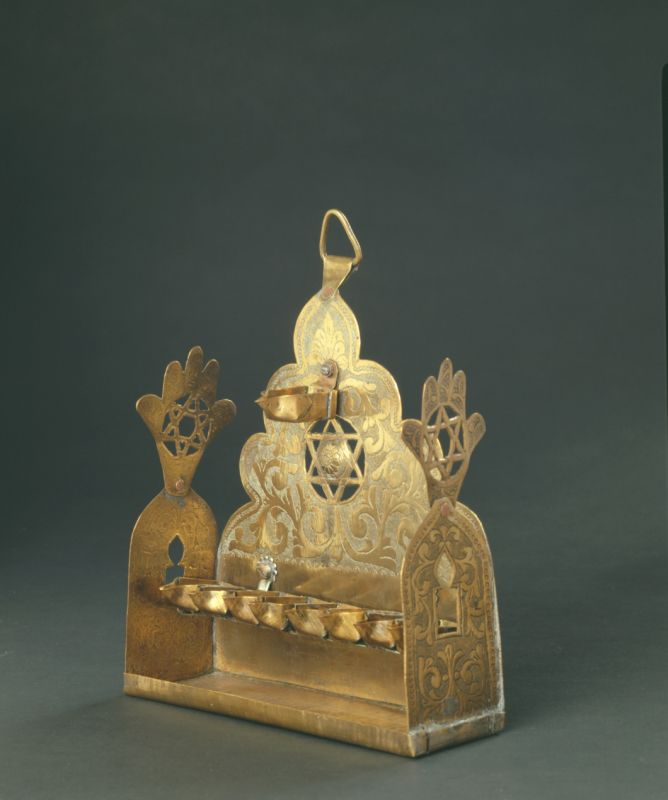 Hanukkah lamp adorned with Stars of David and hamsas
