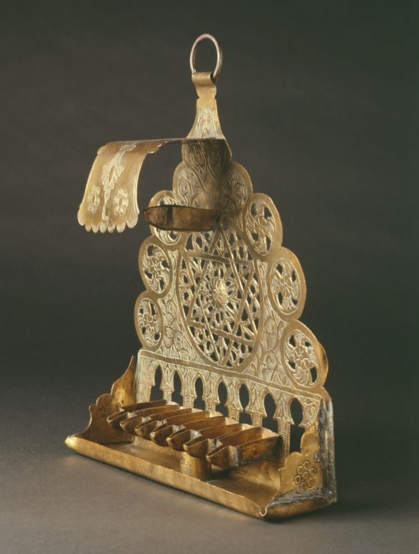 Roofed Hanukkah lamp, decorated in openwork