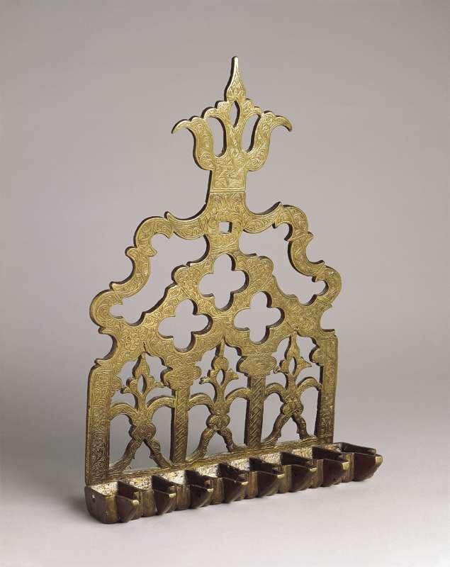 Hanukkah lamp adorned with three demonic figures