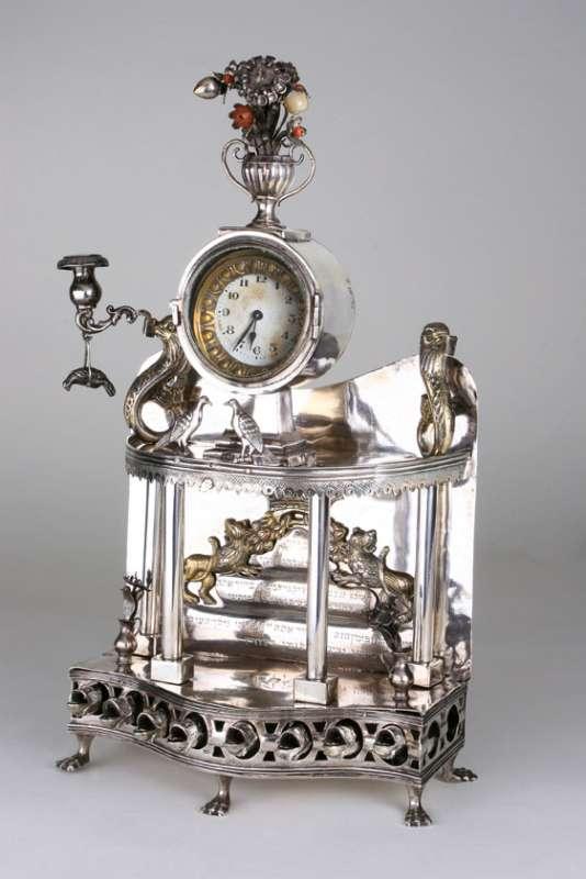 Hanukkah lamp surmounted by clock