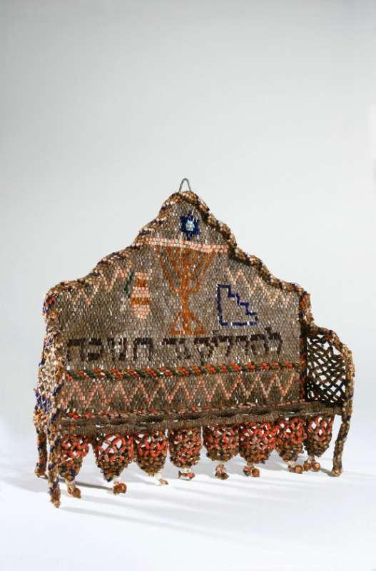 Hanukkah lamp made of glass beads