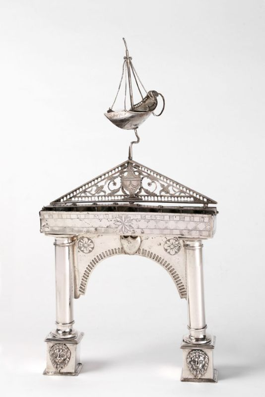 Hanukkah lamp in the form of a gate surmounted by a servant light shaped like a sailboat