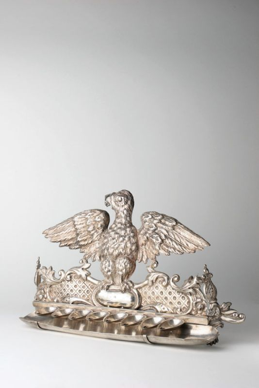 Hanukkah lamp with depiction of eagle with outspread wings
