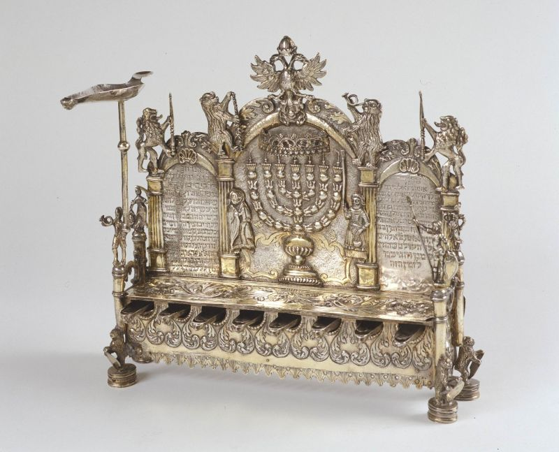Hanukkah lamp inscribed with blessings, and adorned with warriors, lions, and bears