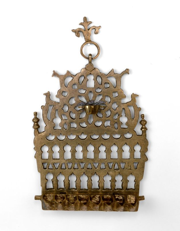 Hanukkah lamp adorned with rows of arched pointed windows