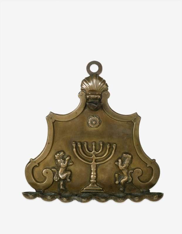 Hanukkah lamp adorned with family emblem featuring menorah and rampant lions