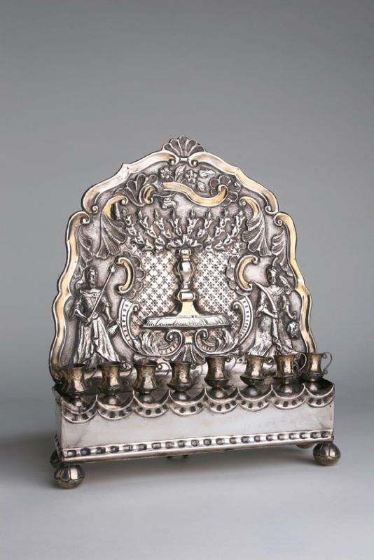 Hanukkah lamp with the figure of Judith lighting the menorah and her maidservant