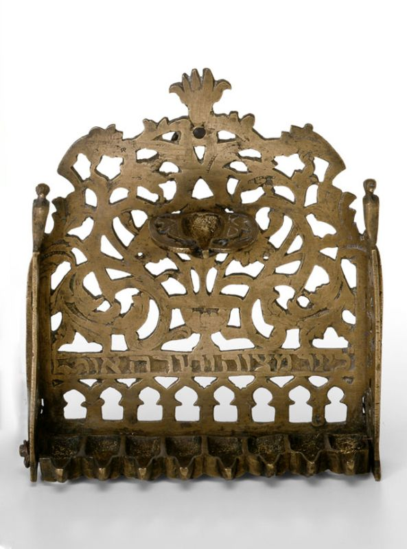 Hanukkah lamp adorned with row of gates, foliage and Hamsah