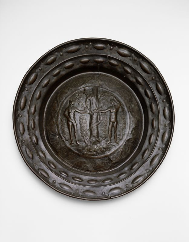 Plate adorned with the scene of Eve offering the apple to Adam