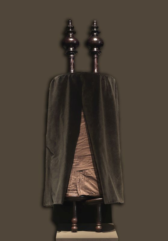 Portuguese-style Torah scroll wrapped in black and wooden finials for 9th of Av