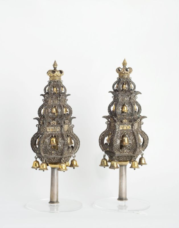 Torah finials decorated with a family emblem and monograms