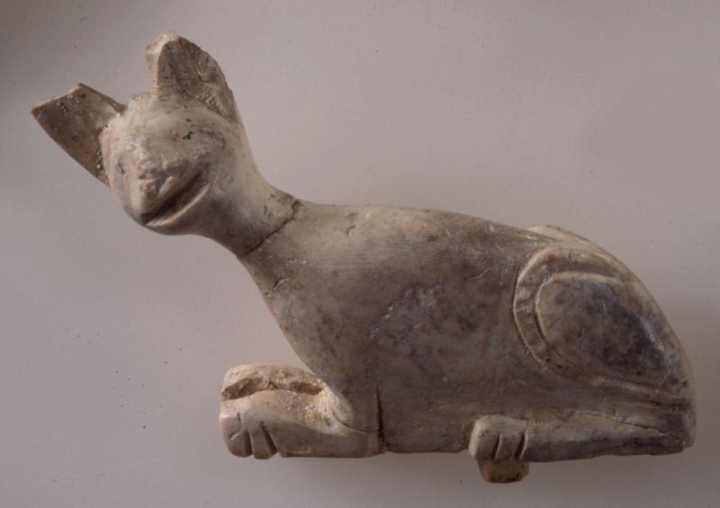 Statuette of a cat with a tang for attachment at the bottom