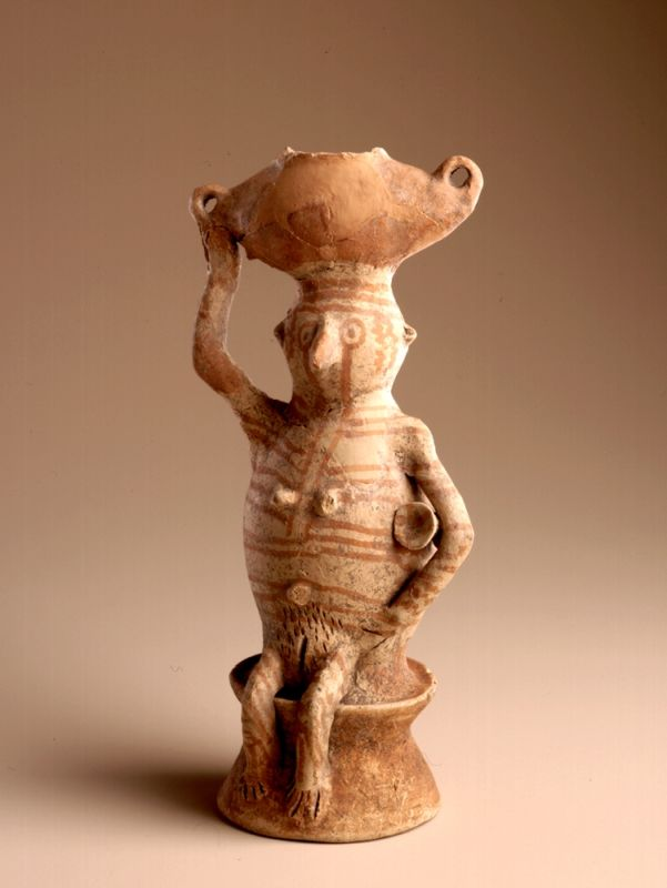 Vessel in the shape of a woman carrying a churn