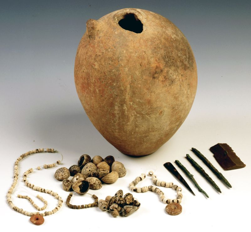 Set of jeweler's tools and jewelry stored in a small jug