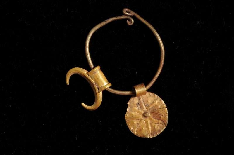 Earring bearing divine symbols