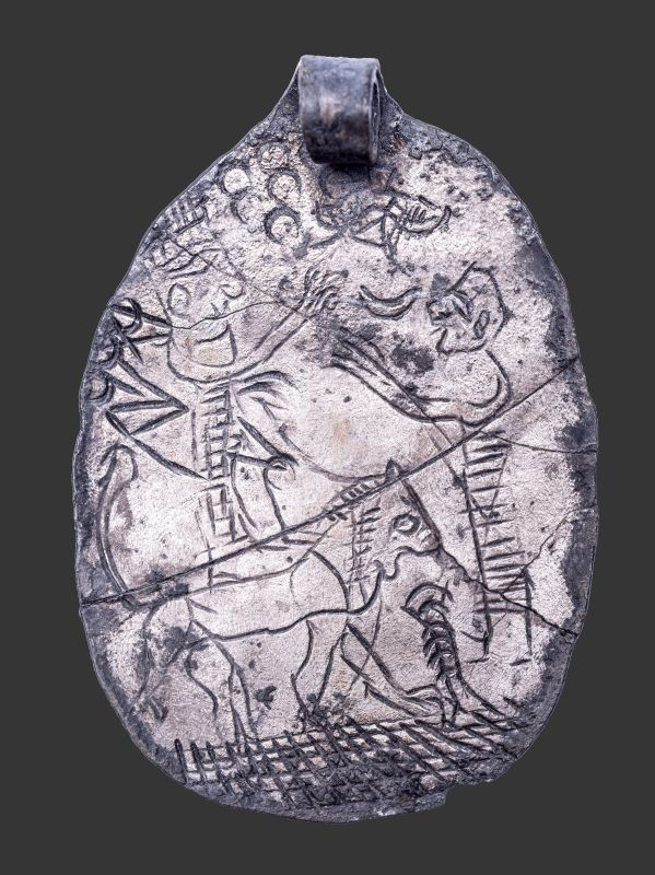 Amulet from silver hoard incised with a cultic scene depicting the goddess Ishtar