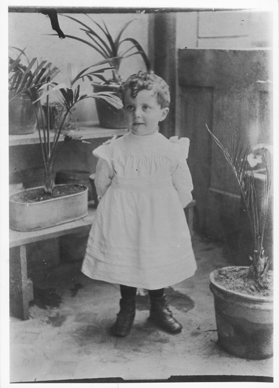 Little boy from the Yona family wearing a dress, as was the custom to ward off the evil eye