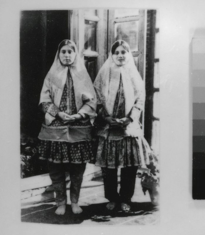 Two girls in traditional attire
