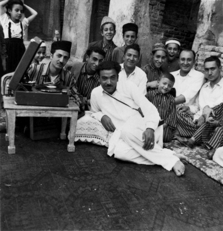 Men in a courtyard celebrating a <i>Shabbat Hatan</i> (Bridegroom's Sabbath)