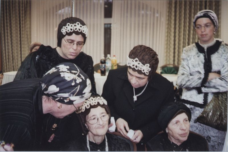 Women from the Spinka court wearing a <i>shterntikhl</i> head covering at a family wedding