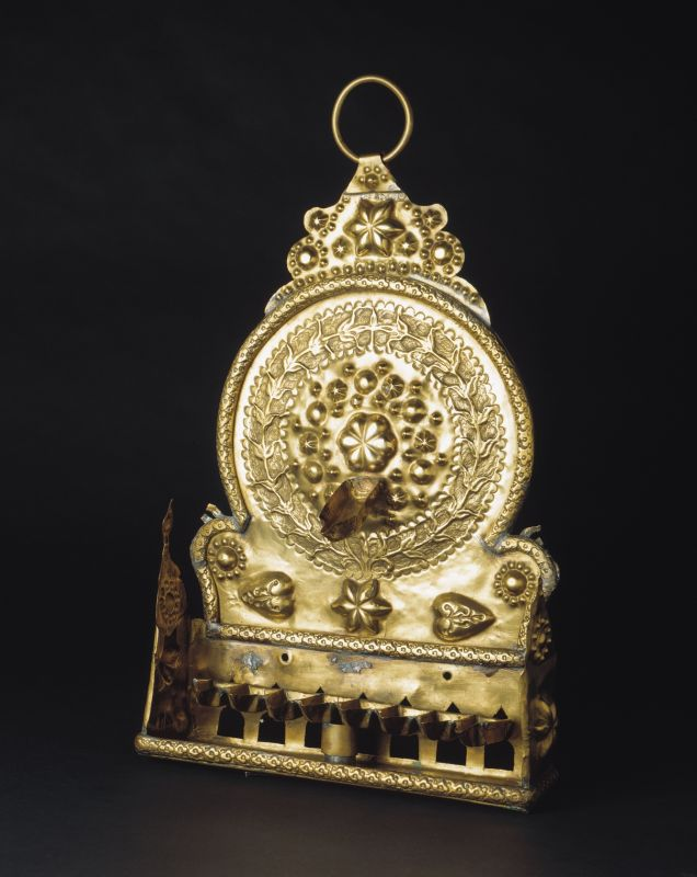 Hanukkah lamp decorated in high relief