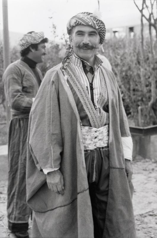 Man wearing machine-embroidered suit and overcoat (<i>'abayye</i>) in the style of the Aqra region, Iraqi Kurdistan