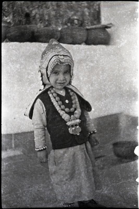 Small Jewish boy dressed like a girl, as was the custom to ward off the evil eye