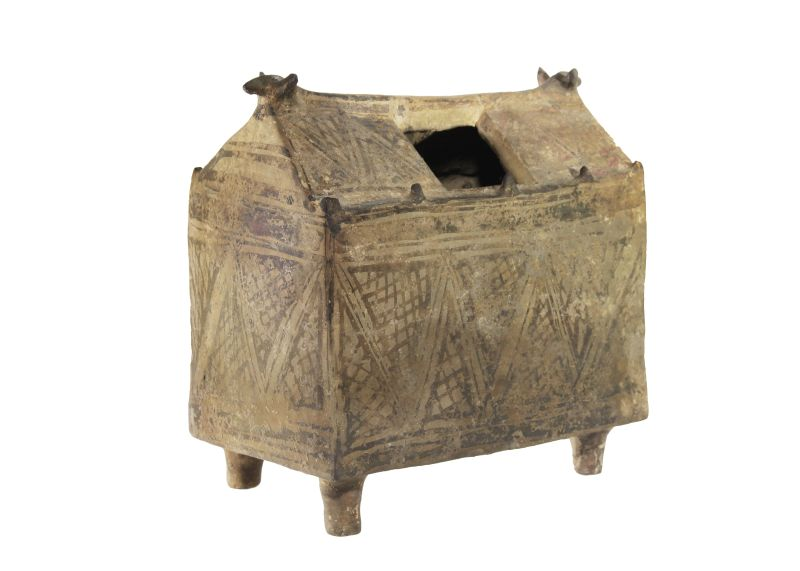 """Hut-shaped cinerary urn with animal-head """"roof"""" decorations"""