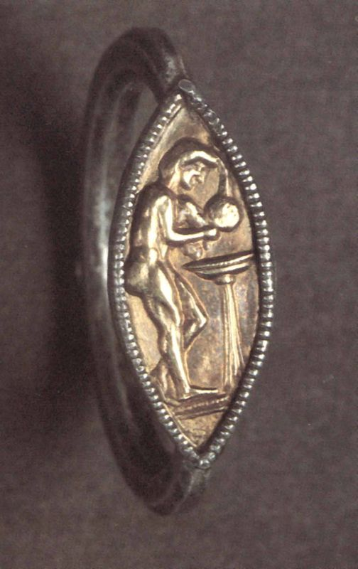 Finger ring depicting a woman washing