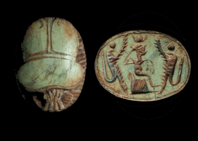 Phoenician scarab depicting the goddess Isis seated on a throne flanked by winged uraei