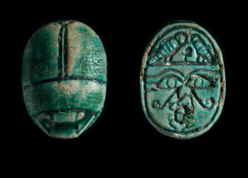 Scarab depicting a symmetric design of good-luck protective signs