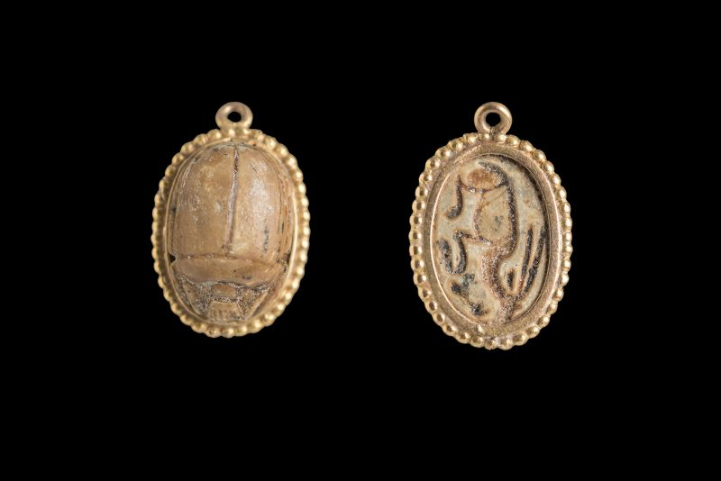 Scarab depicting a reclining caprid with a