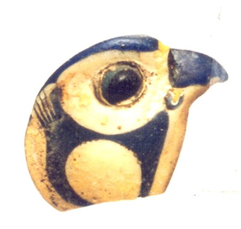 Falcon-headed inlay representing the Egyptian god Horus