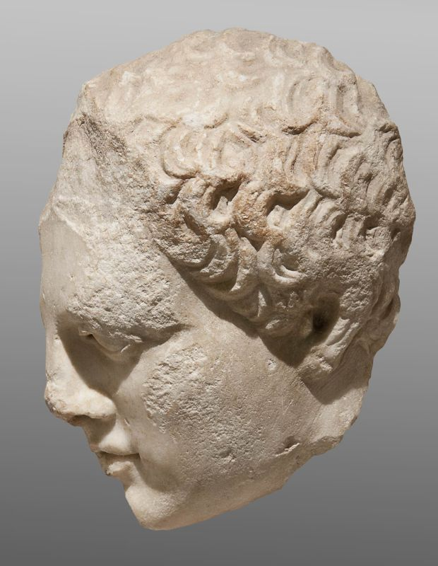Head of a youth, fragment of a funerary stele