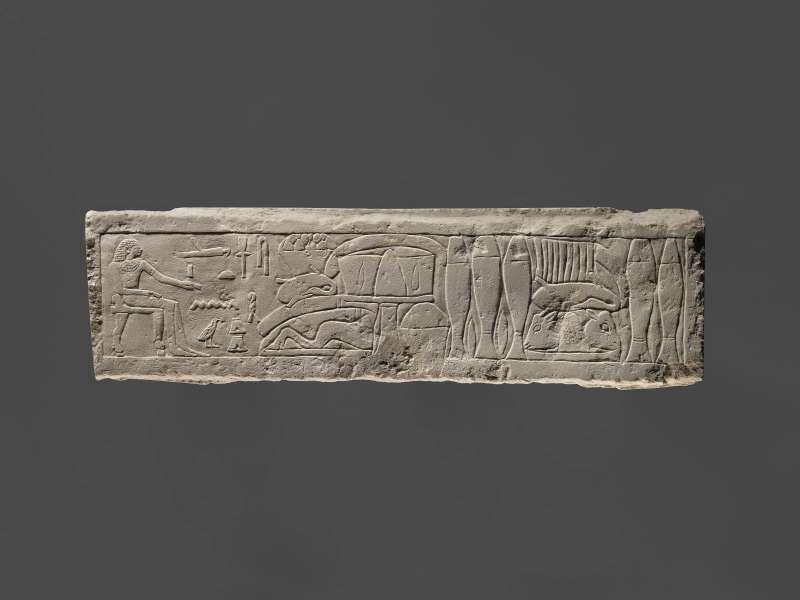 תבליט קבר המתאר את חֶנְ-גֵּגוּ, בן לווייתו