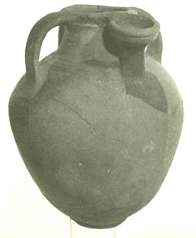 Jar with a hollow holder for a dipper juglet