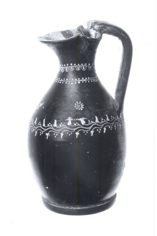 <i>Oinochoe</i> (wine jug) painted in white, with a garland, tongues, and rosette