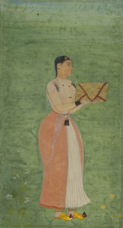 Indian woman holding a wrapped manuscript