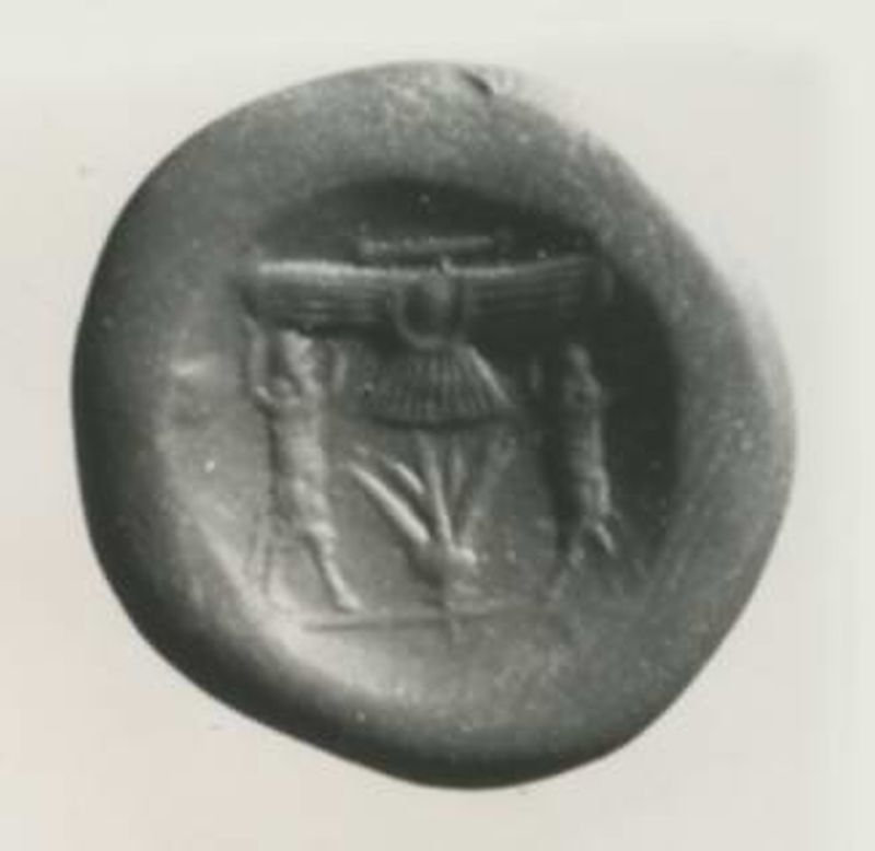 Stamp seal depicting a winged disk-and-crescent representing Ashur, the main Assyrian god