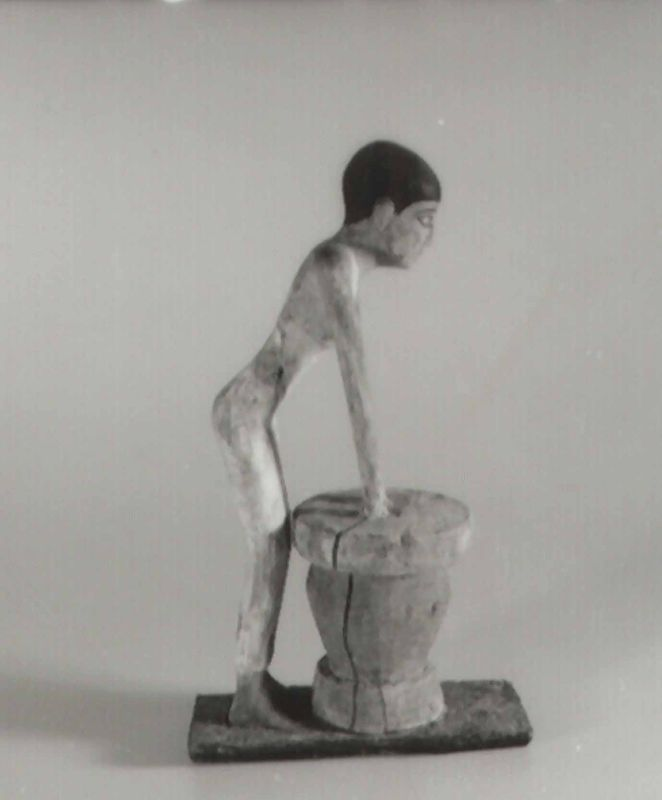 Statuette of a woman kneading dough used to make beer, the most common alcoholic beverage in Egypt and a dietary staple