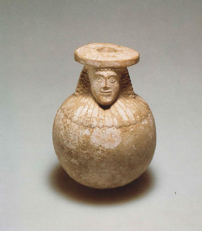 Round <i>aryballos</i> (oil bottle) depicting a woman's head