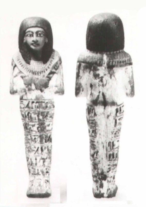 "<i>Shabti</i> of the ""Chief of Weighing/Measuring, Huy,"" clasping the customary hoe and pick and inscribed with the traditional spell"