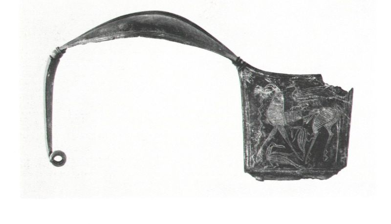 Oversized, boat-shaped <i>fibula</i> (brooch), decorated on both sides