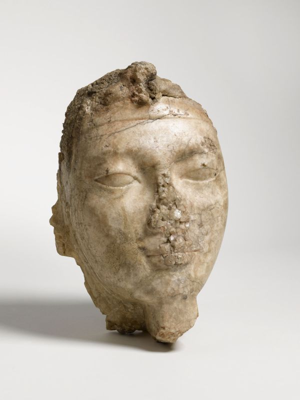 Head of a king with a <i>uraeus</i> at his brow, fragment from a larger-than-life royal statue