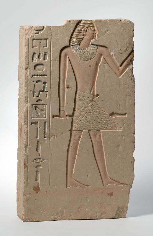 Tomb relief depicting the deceased, whose name is lost, holding a scepter customarily held by high officials