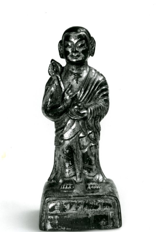 Standing figure of a Buddhist disciple