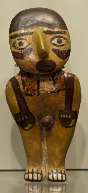 Male figure wearing a spondylus shell necklace